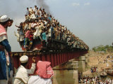 Hundreds of Muslim Pilgrims Ride on a Train Passing on a Bridge at Gazipur Photographic Print