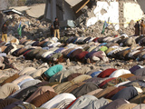 Kashmiri Eartquake Survivors Pray Amid the Debris of a Destroyed Building During the Eid Al-Fitr Photographic Print