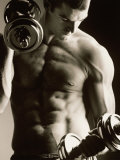 Close-up of a Young Man Working Out with Dumbbells - Fotografik Baskı