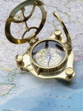 Compass on a Map Photographic Print
