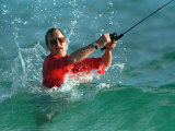 Waves Splash President-Elect George Bush as He Casts a Line While Surf-Fishing Photographic Print