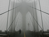 A Lone Runner Makes His Way Across the Fog-Shrouded Brooklyn Bridge Christmas Morning Photographic Print