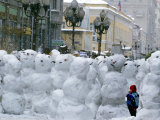 A Child Plays Among the Snowmen Made at the Arbat Photographic Print