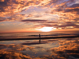 A Young Boy Takes an Early Morning Jog as the Sun Rises Along China Beach Photographie
