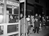 Stranded New York Workers Wait Patiently in a Long Line to Use a Phone Booth to Call Home Photographic Print