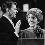 Nancy Reagan Proudly Watches as Her Husband Ronald Reagan Takes the Oath of Office Photographic Print