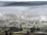 A Small Plane Descends Over Fog Covered Reeves Municipal Golf Course Photographic Print