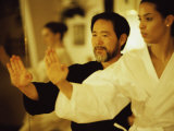 Mature Man Teaching a Young Woman Martial Arts Photographic Print