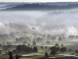 A Small Plane Descends Over Fog Covered Reeves Municipal Golf Course as It Lands at Lunken Airport Photographic Print