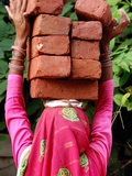 An Indian Woman Construction Worker Stacks Bricks on Her Head Photographic Print