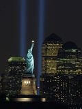 Lights from the Former World Trade Center Site Can be Seen on Both Sides of the Statue of Liberty Photographic Print