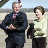 President Bush and First Lady, Laura, Carry Their Dogs Photographic Print