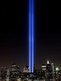 The Tribute of Light Memorial Shines into the Sky Over the Night Skyline of New York City Photographic Print