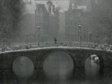 A Lone Pedestrian Makes His Way Across a Bridge Photographic Print