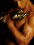 Young Man Exercising with Dumbbells Photographie
