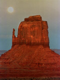 The Moon Rises Over a Butte Known at the Mitten at Monument Valley Navajo Tribal Park Photographic Print