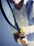 Close-up of a Young Man Holding a Tennis Racket and a Tennis Ball Impresso fotogrfica