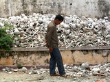 A Cambodian Man Walks Past One of the Many Killing Fields Sites Photographic Print