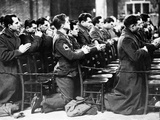 American Soldiers are Seen at Prayer During a Catholic Mass on Thanksgiving Day Photographic Print
