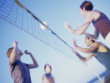 Low Angle View of Two Young Couples Playing Beach Volleyball Photographic Print