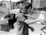 A South Vietnamese Father Carries His Son and a Bag of Household Possessions Photographic Print