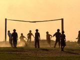 Children from the Toba Qom Ethnic Group Play Soccer During Indegenous Indian Day Celebration Lámina fotográfica