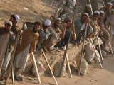 A Group of Afghan Construction Daily Workers Wait to be Hired Photographic Print