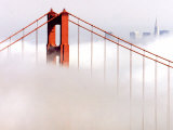 Fog Swirls and Covers All of Golden Gate Bridge Save the North Tower and the Tips of Skyscrapers Reprodukcja zdjęcia