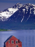 Small Farm Building and Mountains, Norway Photographie par Walter Bibikow
