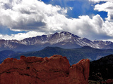 The Sun Breaks Through the Clouds to Highlight the Summit of Pikes Peak Photographic Print