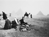 Camel Jockeys at the Giza Pyramids, Cairo, Egypt Photographic Print by Walter Bibikow