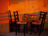 Sunset Light on Cafe Tables, Athens, Greece Photographic Print by Walter Bibikow