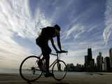 A Lone Cyclists Pedals Along Lake Michigan Photographic Print