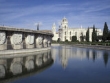 Praca do Imperio Fountain and Jeronimos Monastery, Lisbon, Portugal Photographic Print by Michele Molinari