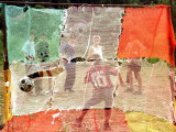 A Soccer Ball Slips Through an Opening of a Makeshift Goal During a Game Played by Bosnian Children Photographic Print