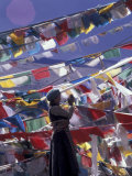 Pilgrim Praying Among Flags, Tibet Photographic Print by Keren Su