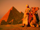 Camel and Driver Resting near the Great Pyramids, Egypt Photographic Print by Alexander Nesbitt