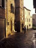 Couple Walking on Narrow Street, Radda in Chianti, Tuscany, Italy Photographic Print by John & Lisa Merrill