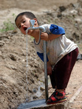 A Young Internally-Displaced Child at a Camp for Displaced Iraqis Who Have Fled Violence Photographic Print