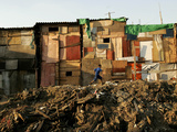 A Child Runs by a Row of Shacks in Novo Mundo Shantytown, Sao Paulo, Brazil Photographic Print