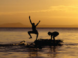 Children Playing on Lake Taupo, Taupo, New Zealand Photographic Print by Michael Coyne