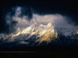 Storm Clouds Over Snow-Capped Mountain, Grand Teton National Park, USA Fotografisk tryk af Carol Polich