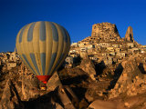 Hot-Air Ballooning Over Town, Uchisar, Turkey Photographic Print by Dallas Stribley