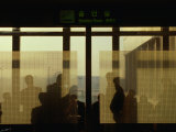 People Silhouetted in Smoking Room at Gimpo Airport, Seoul, South Korea Photographic Print by Johnson Dennis