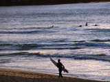 Surfers at Sunrise on Bondi Beach, Sydney, Australia Photographic Print by Glenn Beanland