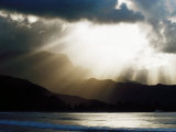 Sun Shining Through Clouds with Mountain Backdrop, Hanalei Beach, Po-Ipu, U.S.A. Photographic Print by Levesque Kevin