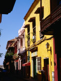 Colonial Facades in Street, Cartagena, Colombia Photographic Print by Wayne Walton