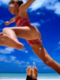 Girl Jumping Dad's Legs, Seychelles Photographic Print by Philip Smith