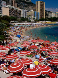 Overhead of Red Sun Umbrellas at Larvotto Beach on Busy Summer's Day, Monte Carlo, Monaco Photographic Print by Dallas Stribley
