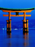 Floating Torii (Gate) at Night with City in Background, Miyajima, Japan Photographic Print by Frank Carter